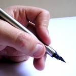 Man holding a pen