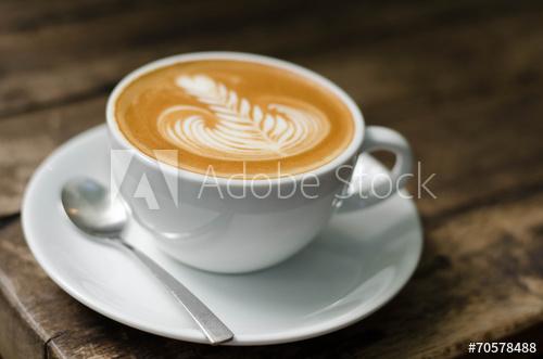 Cup of foamy vanilla latte