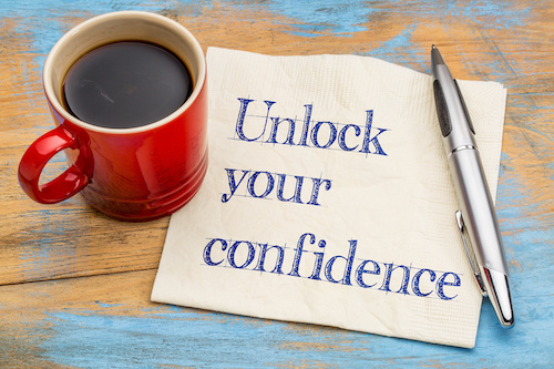 "A cup of coffee with a message ""Unlock your confidence"""